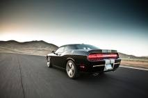 2013-Dodge-Challenger-SRT8-392-rear-three-quarter-in-motion